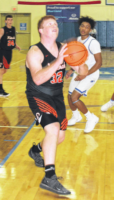Whiteoak senior Zach Rand makes a move in the lane on Friday, January 4, at Washington High School where the Wildcats battled the Blue Lions in varsity boys basketball action.