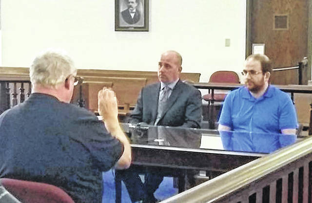 Benjamin Wright, right, is shown in Highland County Common Pleas Court with defense attorney J.D. Wagoner, middle. At far left is sign language interpreter Bob Coltrane.