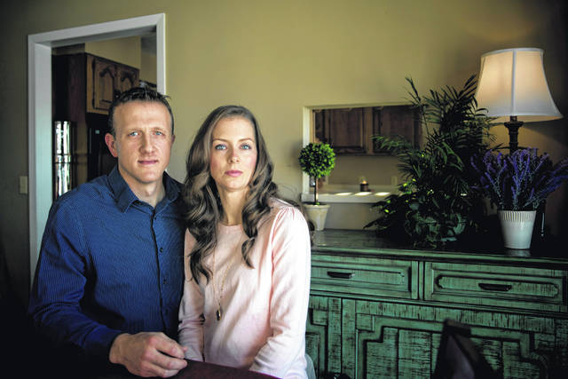 Aaron Roberts poses for a portrait with his wife, Jennifer, in their home in Hillsboro, Ohio Wednesday, December 27, 2017. Roberts was falsely arrested in November 2015 for drug trafficking and possession charges in a school zone. He spent a night in jail and is trying to clear his name and dispel all the rumors with a federal lawsuit.