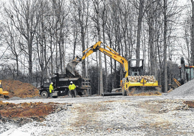 Workers use heavy equipment Monday to work on expanded parking off Fenner Lane at Highland District Hospital.