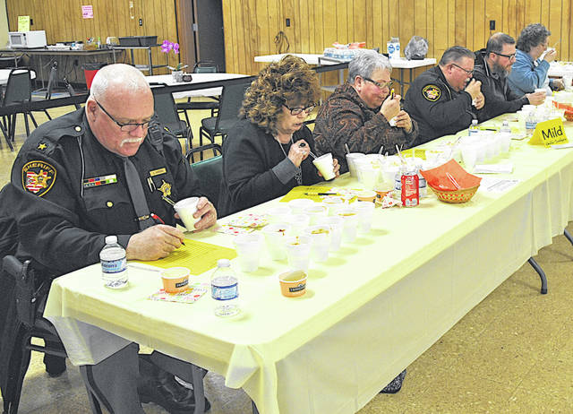 """Judges Wednesday afternoon at the """"mild"""" table for the 15th annual Chili Challenge included, from left, Highland County Sheriff Donnie Barrera, Sharon Hughes of The Times-Gazette, Nikki Eyre, Nick Thompson of the sheriff's office, Bryce Matson with WCHO/WSRW and Koni Boatman of the Highland County Senior Citizens Center."""