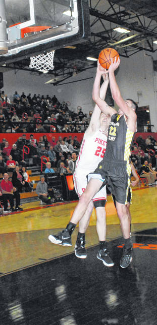 Lynchburg-Clay's Ray Conner attempts to finish the fast break with a layup in the first half of the Mustangs Southeast Sectional Semi Final game against the Piketon Redstreaks on Tuesday at Waverly High School.