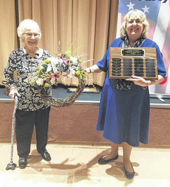 Elinor Cornelius, left, is presented with a wreath by Shawn Priest in honor of Cornelius being named Republican Woman of the Year.
