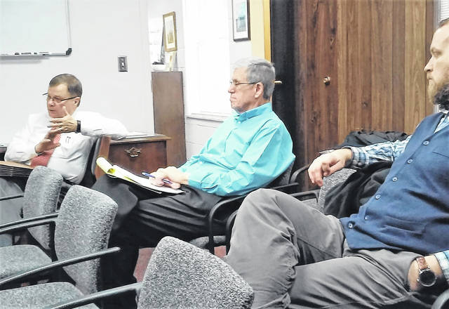 Highland County Common Pleas Court Judge Rocky Coss, left, briefed county commissioners Monday on plans to establish a drug court. Taking note of Coss' comments were Highland County Auditor Bill Fawley, center, and Health Commissioner Jared Warner.