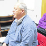 Engineer briefs commissioners on projects