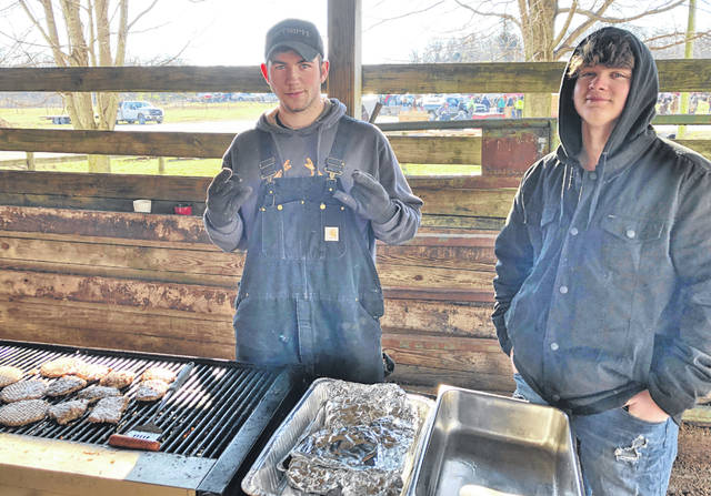 Pictured are Luke Middleton, left, and Lance Hetzel grilling for the auction.