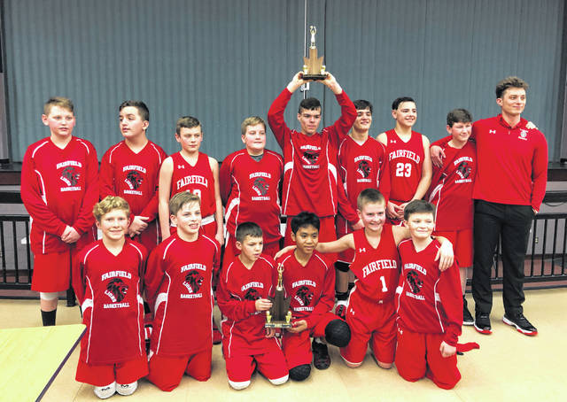 The Fairfield Middle School 7th grade boys basketball team poses for a picture with their SHAC League Tournament Championship trophies at Peebles High School on Saturday, February 9, after they beat the North Adams Green Devils in the championship game. Pictured front row(l-r): Britton Campbell, Gabe Fouch, Nolan Campbell, Janre Lerio, Larkin Friend, and Brayden Davis. Pictured back row(l-r): Daniel Ward, Timmy Williams, Brantin Dawson, Cody Frost, Cade Miller, Trey House, Caiden Fauber, J.D. Duncan, and Coach Quentin Williams.