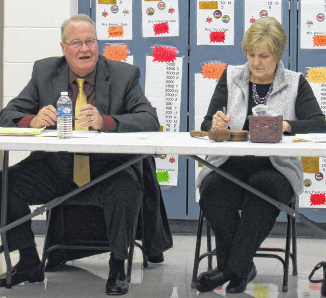 Interim Superintendent Ron Sexton and Greenfield Board of Education President Sandy Free are pictured during Monday's school board meeting at Rainsboro Elementary.