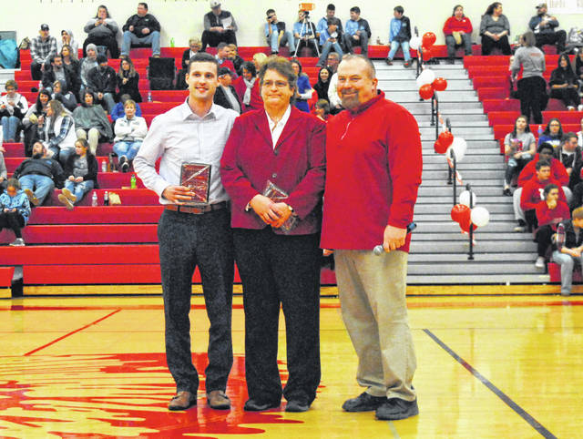 2019 Hillsboro High School Athletic Hall of Fame inductees Jarrod Hart(left) and Julie Kiefer (middle) pose for a picture at halftime of the Indians varsity basketball game on Tuesday, Feb. 5, with current HHS Athletic Director Dave Dietrick.