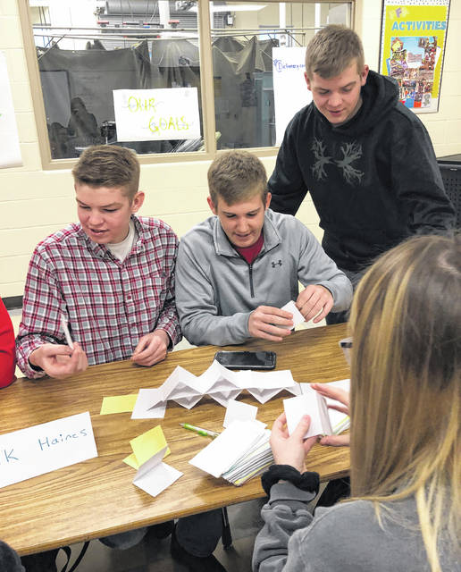 Pictured, from left, are Hillsboro FFA members Brock Haines, Grant Crum and Brennen Priest doing leadership activities.