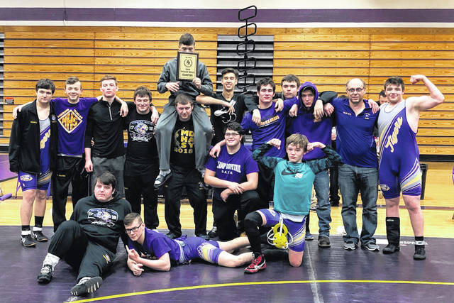 The McClain Tigers' varsity wrestling team poses for a group photo on Saturday at McClain High School where the Tigers hosted the second annual McClain Duals and swept the competition to go 4-0 on the day.