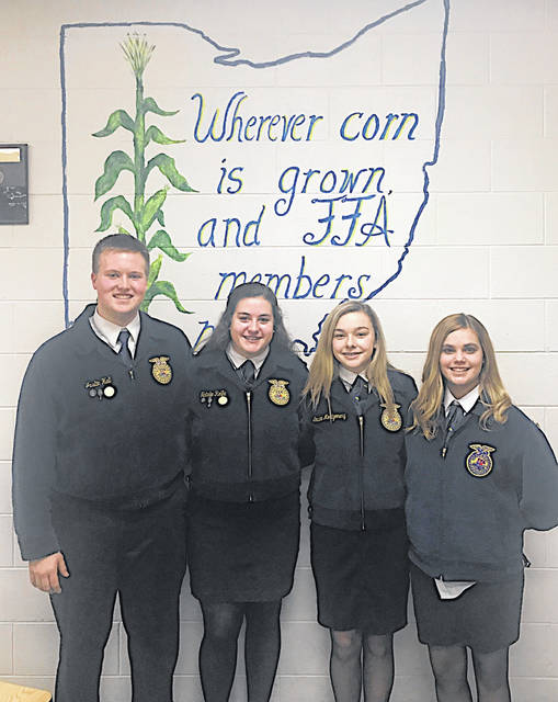 Four members of the McClain FFA Chapter competed recently at a public speaking competition. Emalee Montgomery and Brooklyn Dean competed in the creed speaking competition where they were required to recite the five paragraph FFA creed and then answer questions. Natalie Rolfe competed in the advanced prepared division and was required to write and memorize a six- to seven-minute speech and then answer questions. Justin Hall competed in the extemporaneous division. He was assigned a random topic upon arrival and had 30 minutes to prepare a four- to six-minute speech. Dean, Rolfe and Hall earned the right to move on to the district level. Pictured, from left, are Hall, Rolfe, Montgomery and Dean.