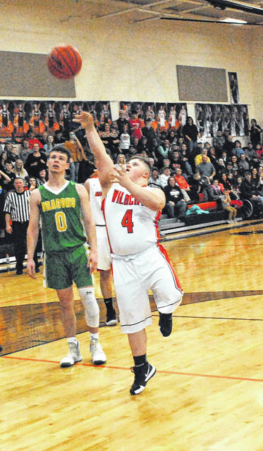 Whiteoak's Nate Frazer attempts a shot in the closing moments of the Wildcats SHAC matchup against the West Union Dragons.