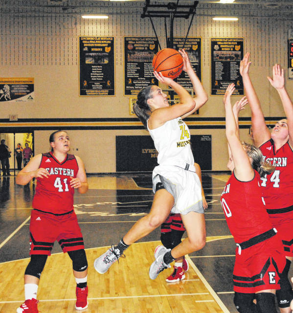 Lynchburg-Clay senior Peyton Scott elevates over two Eastern defenders on Monday at Lynchburg-CLay High School where the Lady Mustangs hosted the Lady Warriors in a matchup of the top two teams in the SHAC.