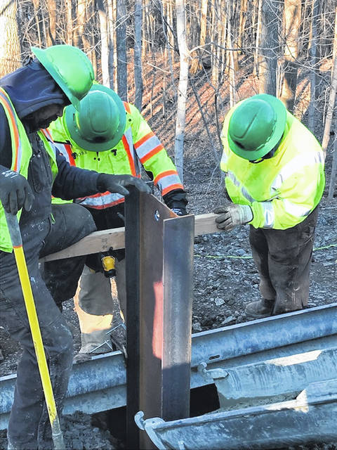 A crew works on an emergency slide repair project on SR 28 in Ross County.