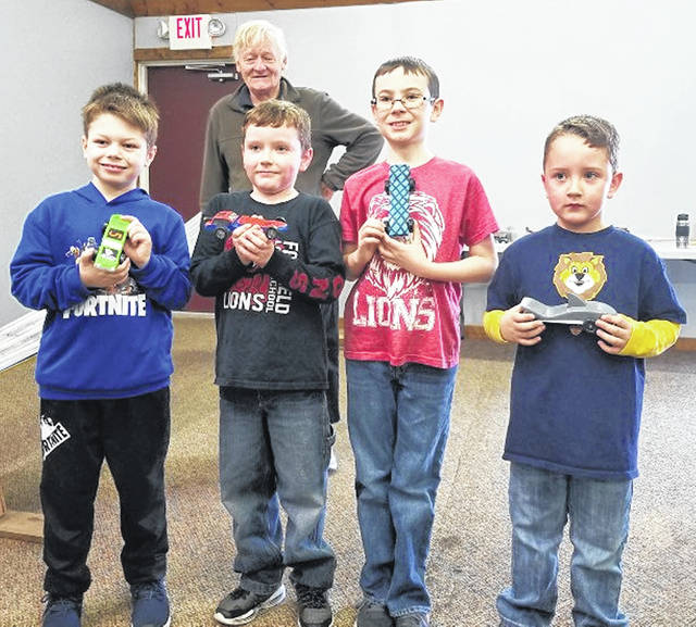 Members of Leesburg Cub Scout Pack 453 had a good turnout for their Pinewood Derby in spite of recent weather. The scouts showed great sportsmanship, cheering during sibling and adult races. Afterward they enjoyed a meal of coneys, chips and drinks followed by group cleanup. Special thanks to Highland County Firemen's Association for use of their annex building and chartering the Scouts another year. Pictured in this photo, (from left, in front) are Landen Barton, Jasper Stanley, Ethan Estes and Ayden Brown. In back is James Frye.