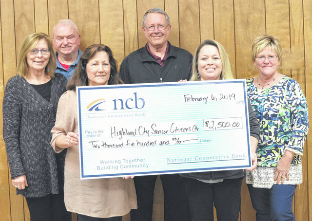 NCB recently donated $2,500 to the Highland County Senior Citizens Center. The money will be used for the center's Meals-on-Wheels program. This program provides hot, freshly-made meals to senior citizens in Hillsboro five days a week. NCB's Jean Boise (front, left) presents a check to Highland County Senior Citizens Executive Director Mechell Frost (front, right) and senior center board members.