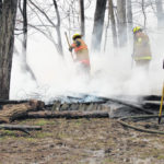 Suspected heat lamp causes shed fire