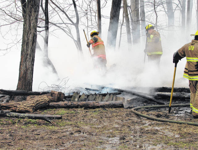 Firefighters from Eastern Joint Fire EMS District in Sardinia are shown extinquishing the flames in what was a storage shed containing straw at the Dehart home on Ruble Lane near Buford. Firefighter/paramedia Mark Peters told The Times-Gazette they had the fire beat down in a matter of minutes after arrival about 5 p.m. Wednesday.