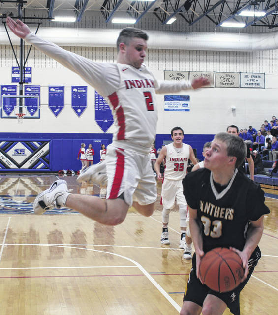 Hillsboro senior Mason Swayne elevates to block the shot of a Miami Trace player on Tuesday at Southeastern High School where the Indians battles the Panthers in a D II Southeast Sectional Semi Final game.