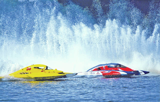 "Boats throw up large ""roosters tails"" of water during past races on Rocky Fork Lake."