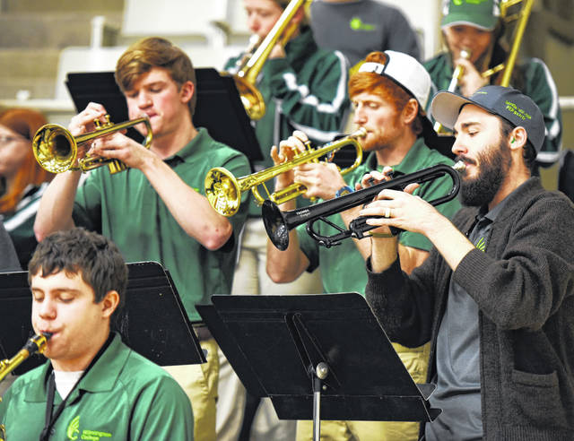 During a recent home basketball game, Wilmington College Band Director Stephen Wadsack, right, plays trumpet alongside Joseph Schmidt, left, and Cameron Phelps. Jordan Moore is playing alto saxophone.