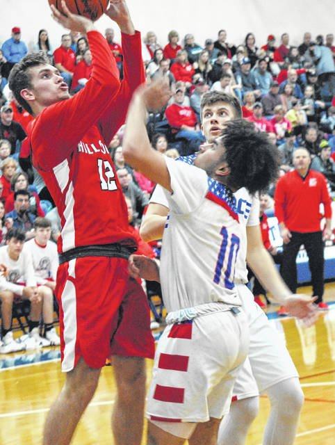 Hillsboro senior Ethan Watson rises fro a jumper on Saturday at Southeastern High School while being defended by Zane Trace's Cam Evans in a D II Southeast Sectional Final tournament game.