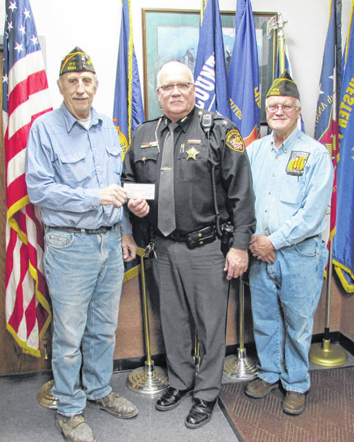 """Hillsboro VFW Post 9094 presented the Highland County Sheriff's Office with a $1,000 check Friday to aid in purchasing replacement tasers for the department. """"We really appreciate it when a local organization like the VFW comes to us with an expression of support like this. It really means a lot,"""" Barrera told The Times-Gazette. Pictured, from left, Are VFW Post Commander Rick Wilkin, Sheriff Donnie Barrera and Post Quartermaster David Pinney."""
