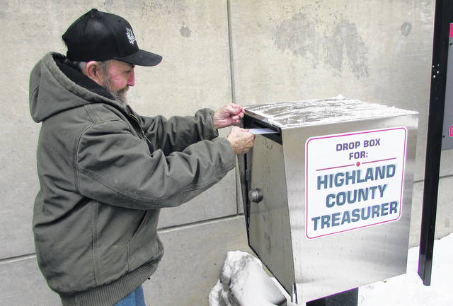 William Holt of Hillsboro is shown using the drop box at the Highland County Administration Building on Friday. Tax bills that were mailed out Friday are due for payment by Friday, March 1, 2019.