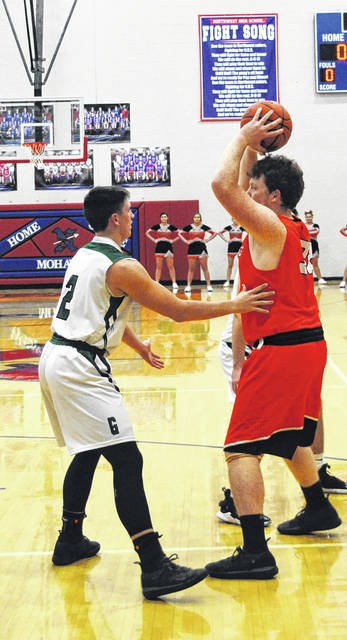 Whiteoak's Zach Rand faces up against a Green defender on Tuesday at Northwest High School where the Wildcats took on the Bobcats in a D IV Southeast Sectional Final game.