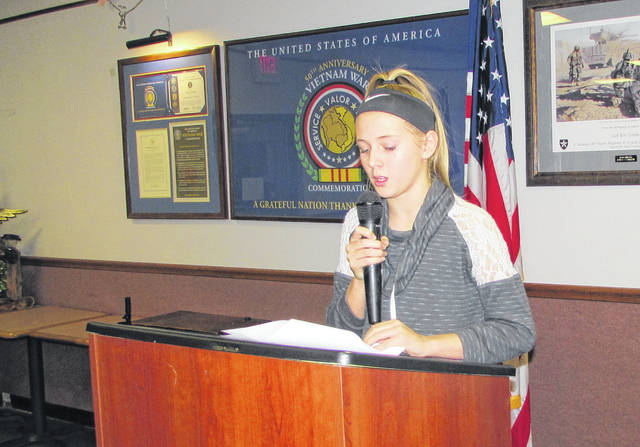 "Brianna Hill, a seventh grader from Bright Local Schools, reads her essay during an awards presentation Friday night at VFW Post 9094 in Hillsboro. Hill's essay of ""Why I Honor the American Flag"" won third place in the Patriot's Pen competition sponsored by the VFW Auxiliary."