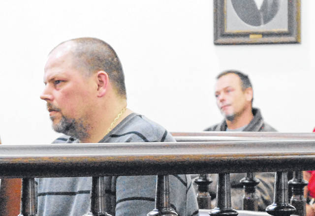Shawn Cambron, foreground, and Ronald Cambron, background, sit in Highland County Common Pleas Court during sentencing hearings on Wednesday.