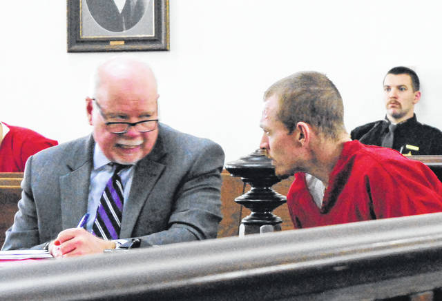 Terry Hester, right, speaks with attorney Bill Armintrout, left, during a Wednesday hearing in Highland County Common Pleas Court.