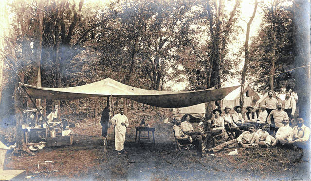 This photo, one of dozens of undated, unidentified pictures kept by the Highland County Historical Society, appears to depict a group of men sitting and standing at an encampment of some sort. There are no identifying markings on the photo. Do you know what's going on in this photo? Where it might have been taken? When it might have been taken? Who is pictured? We're interested. Call us at 937-393-3456, email us at HTGinfo@timesgazette.com or visit us on Facebook at www.facebook.com/TheTimesGazette.