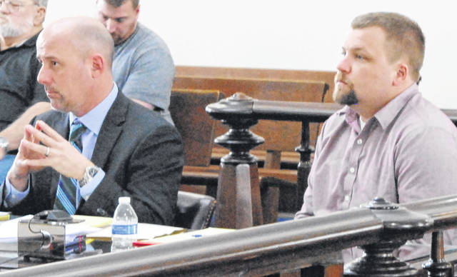 Steven Holland, right, sits in Highland County Common Pleas Court on Thursday with attorney J.D. Wagoner, right.