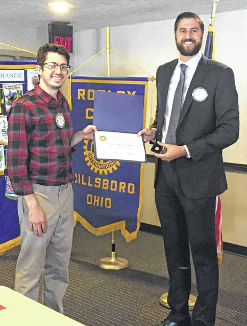 Hillsboro Rotary Club President Matt Greene, right, presents Reid Sharp with a Paul Harris Fellow Award at a recent club meeting.