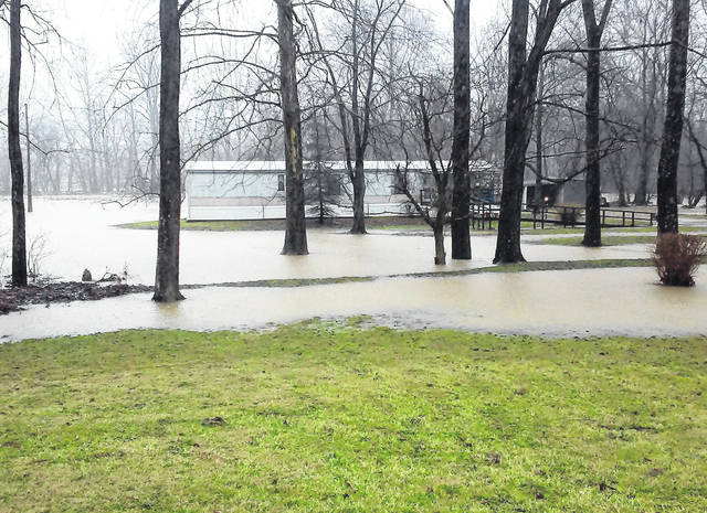 Flood watches have expired except for those communities along the Ohio River, but water from the swollen Rocky Fork Creek is seen here Tuesday afternoon encroaching upon a mobile home on Fettro Road just off SR 124 east of Hillsboro. The flood watch, which expired at 5 p.m. Tuesday, was replaced with a high wind advisory through 7 a.m. Wednesday. According to the Ohio Departmentof Transportation District 9, the following roads in neighboring counties were closed Tuesday afternoon: SR 124 between Beavers Ridge Road) and SR 772 at Idaho in Pike County; SR 220 at River Road and the CSX Railroad, two miles south of Waverly, in Pike County; SR 104 at the Deer Creek Bridge, between Williamsport Pike and Pennyroyal Road, in Ross County; SR 73 at the Second Street Bridge and the city of Portsmouth in Scioto County; SR 73 at the U.S. 52/SR 852 overpasses, west of Portsmouth, in Scioto County; and SR 239 between U.S. 52 and SR 73 at West Portsmouth in Scioto County.