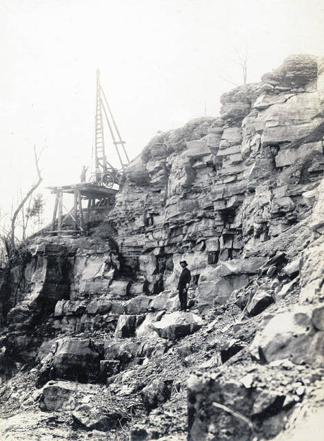 "This photo, one of dozens of unidentified pictures kept by the Highland County Historical Society, appears to depict a lone man standing in a quarry or stonework of some sort. The cardstock to which the photo is affixed has an inscription reading, ""Simmons Bros."" Do you know what's going on in this photo? Where it might have been taken? When it might have been taken? Who is pictured? We're interested. Call us at 937-393-3456, email us at HTGinfo@timesgazette.com or visit us on Facebook at www.facebook.com/TheTimesGazette."