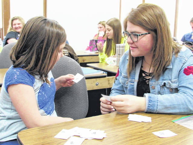 "Angel Merritt, left, and Maysun Faulconer share an activity during the lunch time ""Lunch Buddies"" program at McClain High School in Greenfield. The mentoring program is under the umbrella of Big Brothers/Big Sisters of South Central Ohio and is funded through a grant from the Paint Valley ADAMH Board."