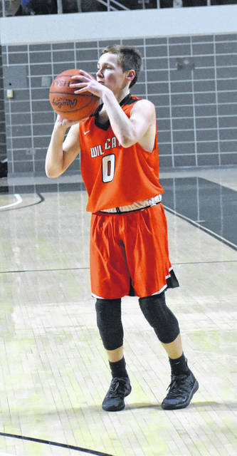 Whiteoak Freshman Bradley Ashbaugh prepares to shoot a deep three pointer on Sunday at the Convocation Center in Athens where the Wildcats battled the Waterford Wildcats in a D IV Southeast boys District Semifinal game.