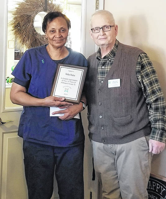 "Retha Burns, a caregiver at Bell Gardens Place, recently received a recognition award for her 18 years of dedicated service. Michael Bradford, Bell Gardens executive director, said, ""Retha is a very valuable and dependable employee at Bell Gardens. She is so kind and dedicated to the residents and their care. We are so thankful to have Retha on our staff, and proud to recognize her years of service."""