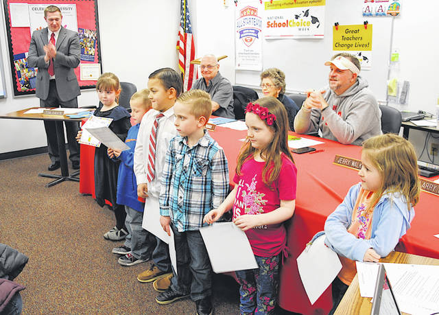 Superintendent Tim Davis, far left, applauds as Hillsboro kindergarten students were honored with character awards for showing respect at Monday's board of education meeting. Pictured, from left, are Emerie Basford, Justin Pagett, JaZon Young, Levi Carroll, McKenzie Butler and Harper Trainer. Honored but not present for the picture were Sammy Beer, Brandon Maurer, Kingston Captain and Aeralina Montalvo.