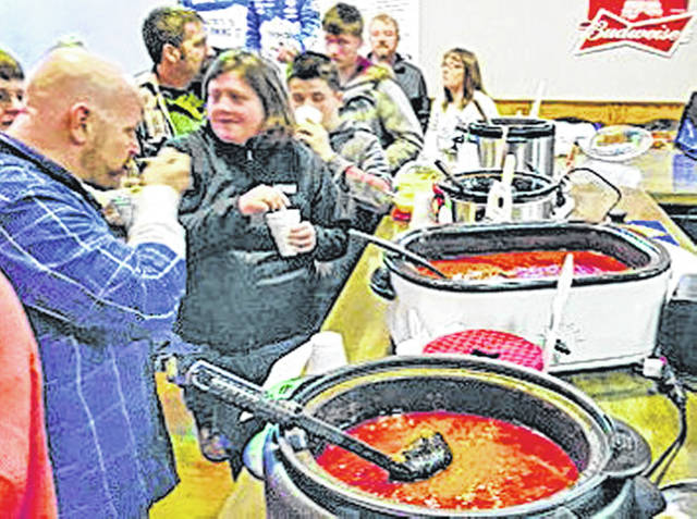 Attendees sample chili entries at Catch 22 Sports Pub during a past Winter Brews & Stews event in downtown Greenfield.
