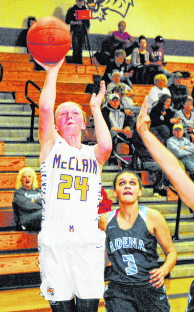 McClain's Kyla Burchett attempts a layup against the Adena Lady Warriors in this Times-Gazette file photo. Burchett was selected Honorable Mention by the OPSWA in D II and is the only female athlete from Highland County to earn All-Ohio honors for the 2018-19 Girls Basketball season.