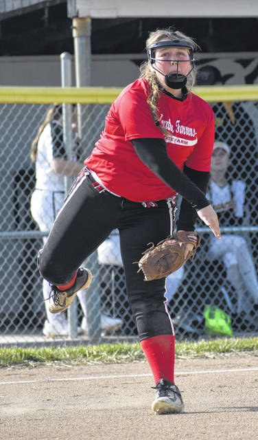 Hillsboro Lady Indians third baseman, Christine Page, throws to first base on Tuesday at Paint Valley High School where the Lady Indians scrimmaged the Lady Bearcats.