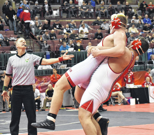 Hillsboro Senior Lane Cluff lifts his first round opponent off the mat before slamming him on Thursday at the Schottenstein Center in Columbus where he competed in the OHSAA State Wrestling Tournament in the 285 pound class.