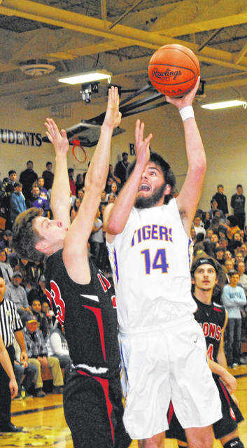 In this Times-Gazette file photo from the January 5, 2019 matchup between McClain and Fiarfield at McClain High School Tigers' Senior Devin Carter attempts a shot over the Lions' Sam Buddlemeyer. Both Seniors were selected as members of the District 14 All-District teams in D II and DIV. Carter was selected at the Co-Player of the Year in District 14.