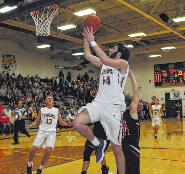 I this Times-Gazette file photo McClain's Devin Carter attempts a layup against the Fairfield Lions. Carter earned Special Mention All-Ohio in D II on Wednesday.