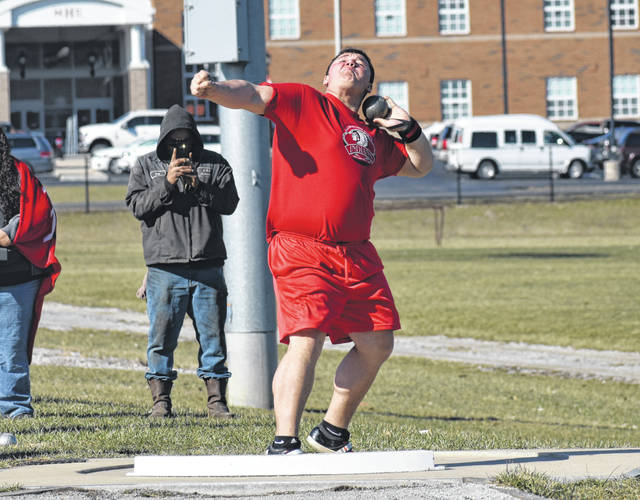 Hillsboro's Draven Stodgel throws the shot put at Hillsboro High School on Tuesday when the Indians and Lady Indians hosted the Washington Blue Lions and Lady Blue Lions in their first home meet of the season.