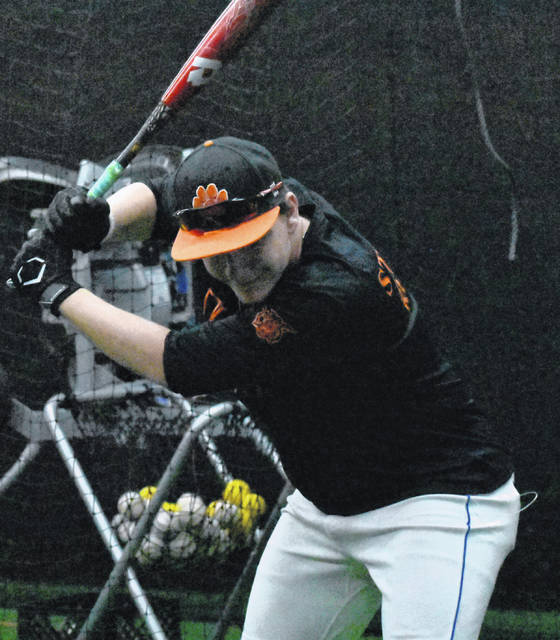 Whiteoak Senior Evan Brill practices hitting at the 'Hack shack' on the campus of Whiteoak High School on Tuesday as part of the Wildcats' preparations for the upcoming season.